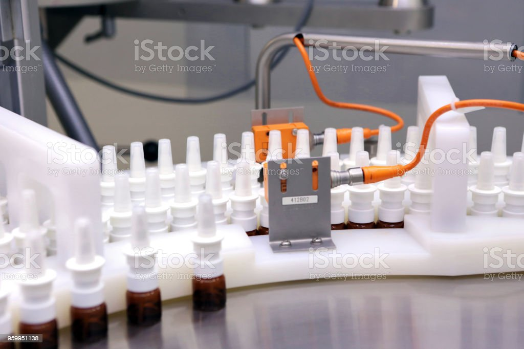 A man works in a pharmaceutical factory. Visual monitoring of the...