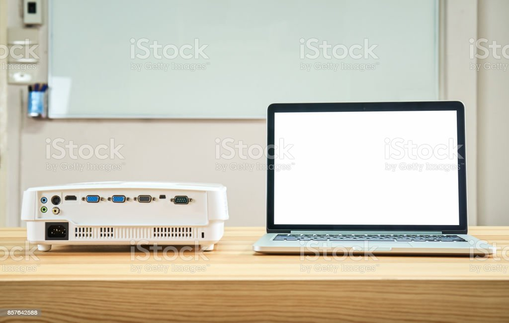 The projector is placed on the table and works with the computer. And ready to serve the people who come to the conference to use the screen to enlarge. stock photo