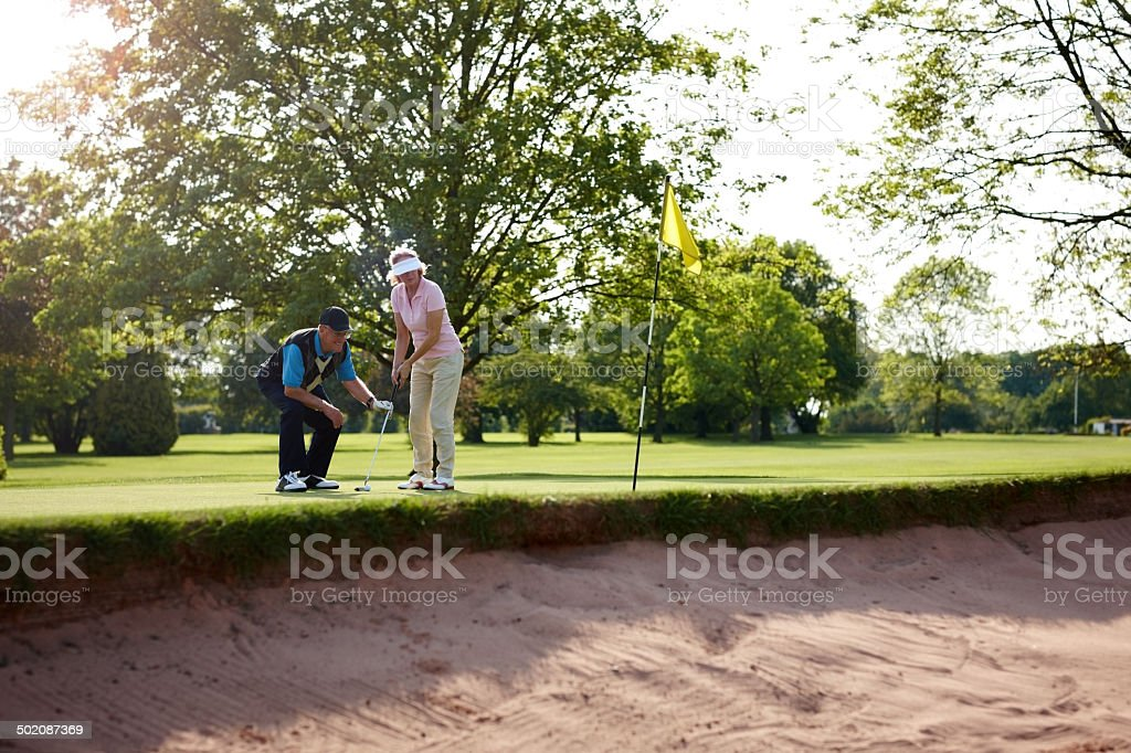 The proper putting technique stock photo