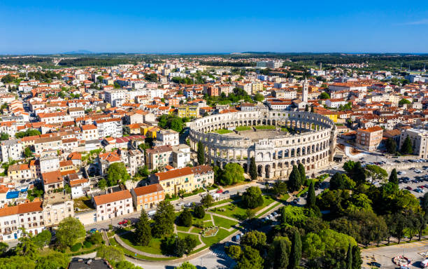 The Pula Arena in Croatia Aerial view of the Roman Amphitheatre in Pula, Croatia croatian culture stock pictures, royalty-free photos & images