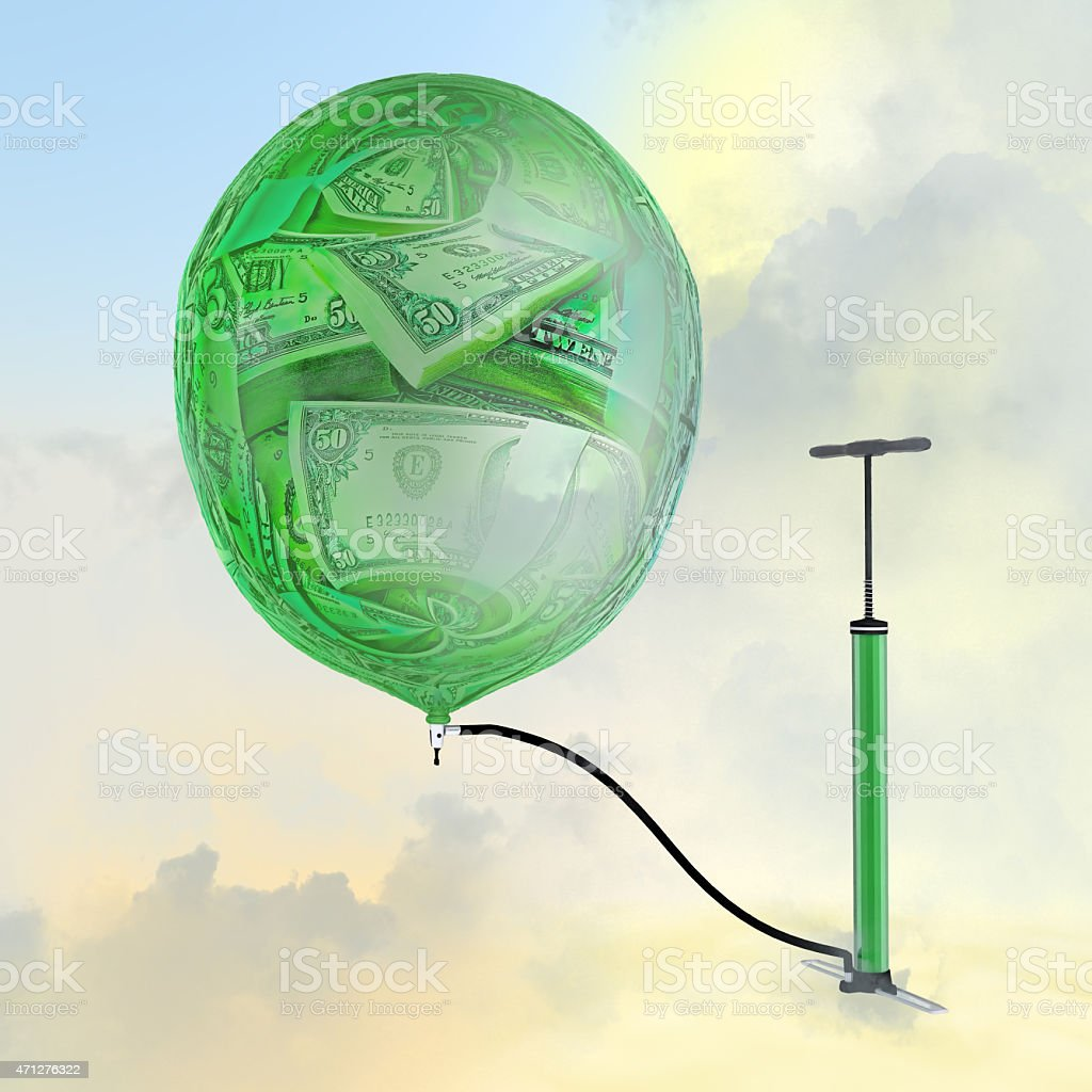 The pump, the balloon with the image of money. stock photo