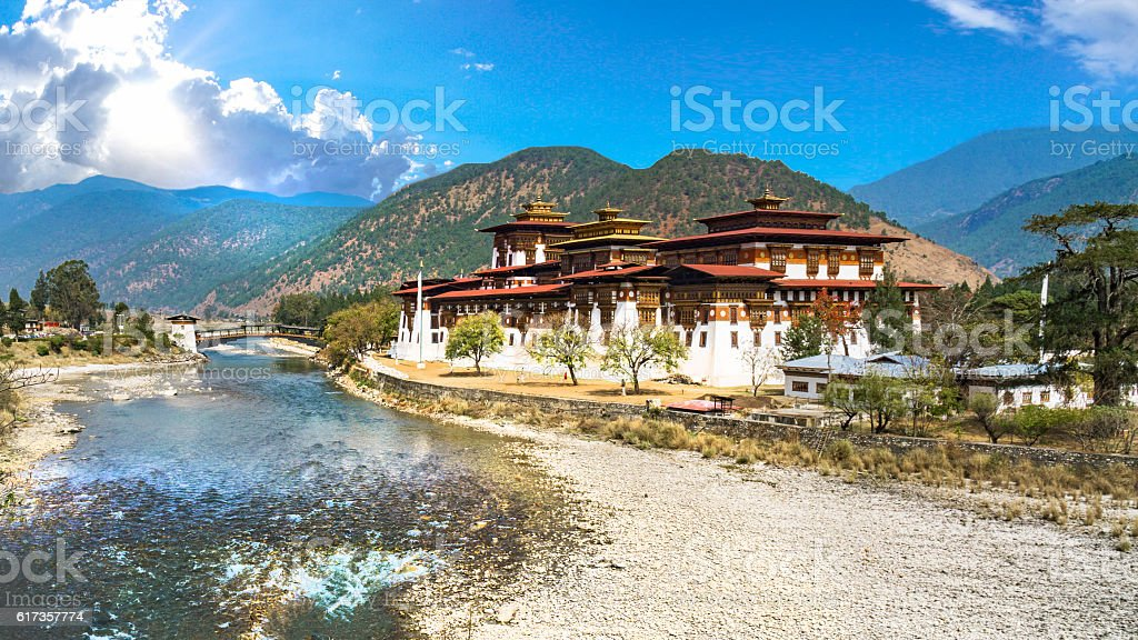 The Punakha Dzong Monastery in Bhutan with landscape and mountains stock photo