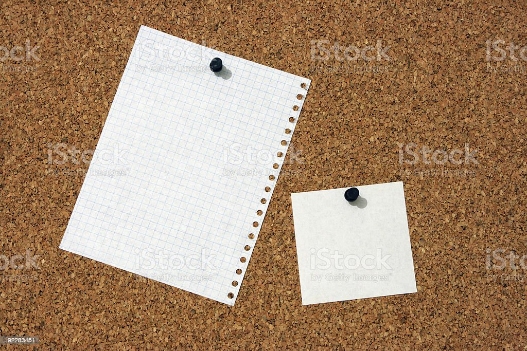 The pure pieces of paper, enclosed to corkboard royalty-free stock photo