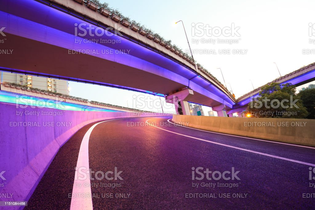 The purple blue LED landscape lamp of city overpass viaduct bridge of...