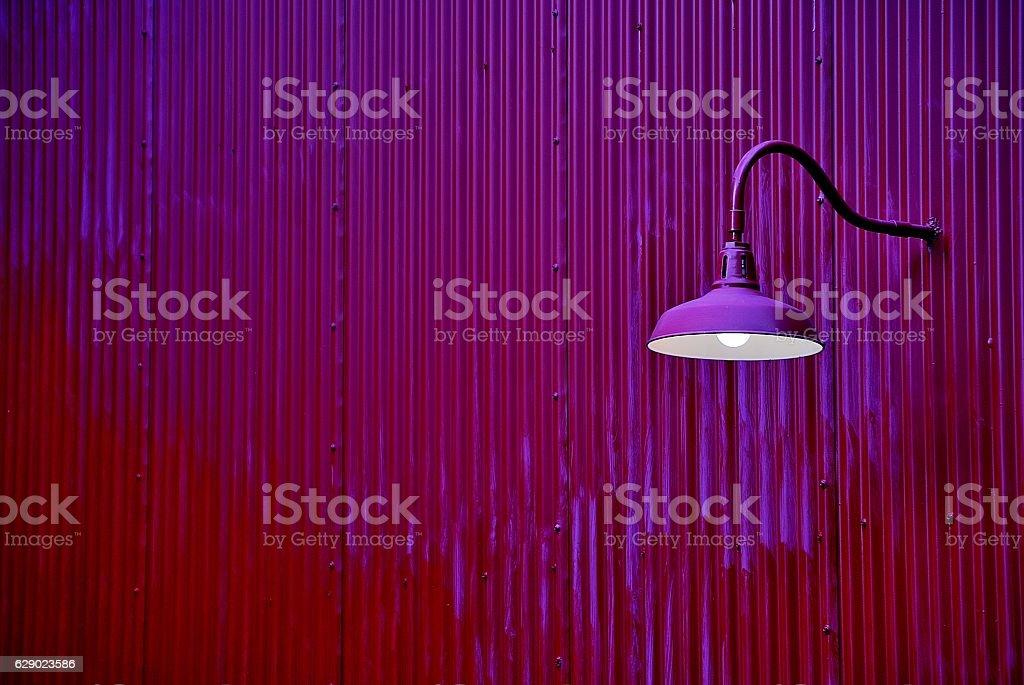 The purple lantern on a purple wall stock photo