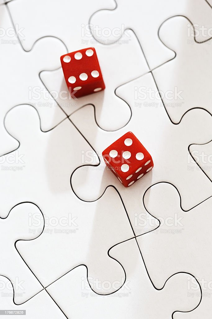 The puzzle of luck: dice on white jigsaw royalty-free stock photo