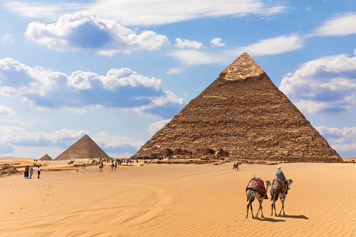 istock The Pyramids and bedouins in the desert of Giza, Egypt 1149887497