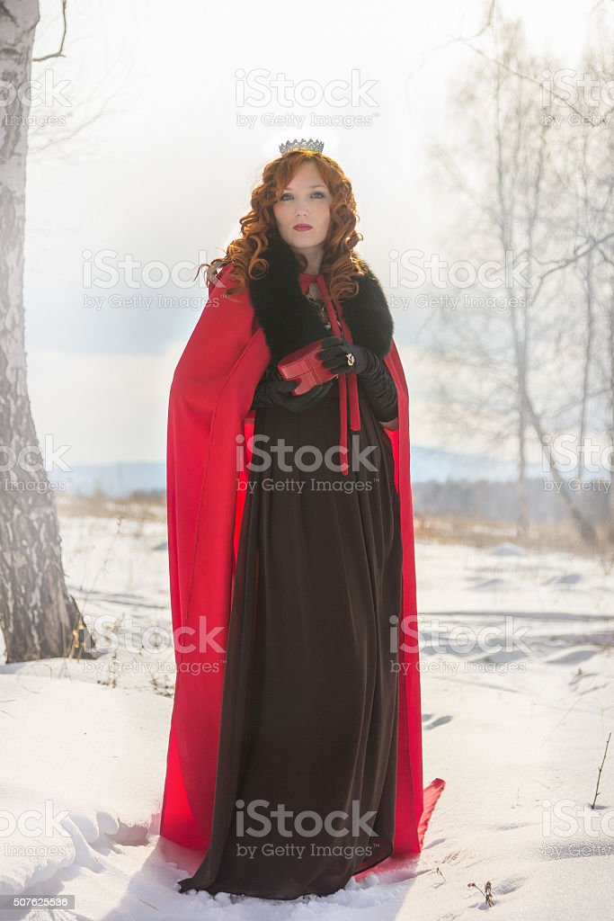 the queen in a red gown stock photo