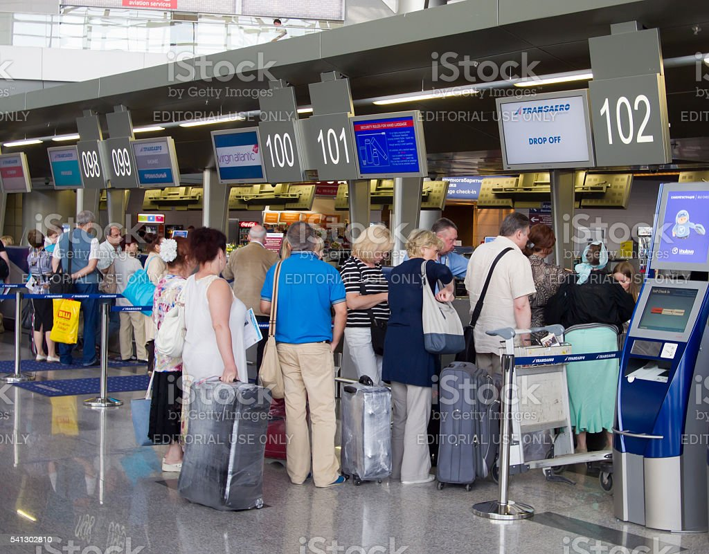 The queue of people in the booking office Vnukovo Airport stock photo