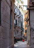 Venice, Italy - September 28, 2015 : The quiet narrow street away from Piazza San Marco in Venice, Italy