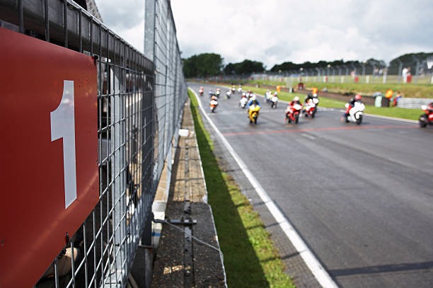 the race for number one - motorbike racing stock photos and pictures