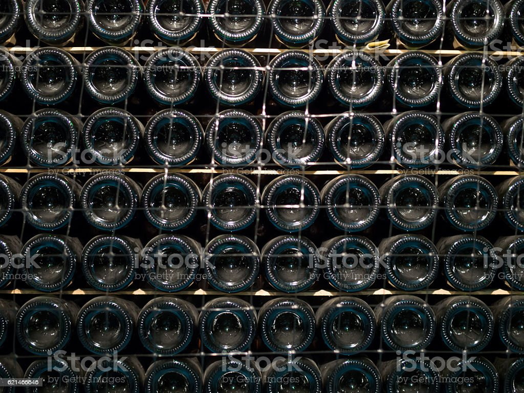 The rack with bottles of wine stock photo