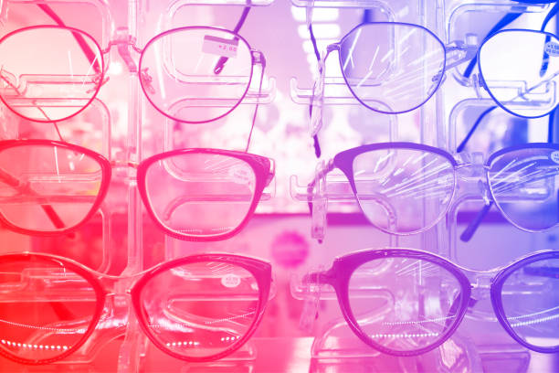 the rack with fashion eyeglasses in the optic store - sale lenses stock photos and pictures
