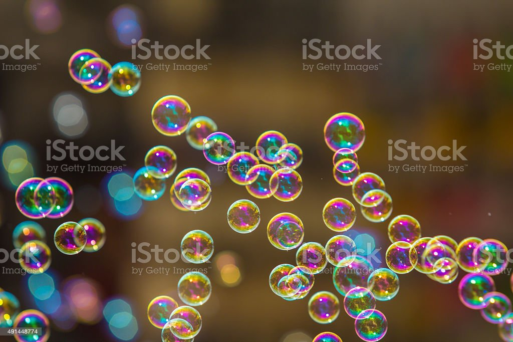 The rainbow soap bubbles from the bubble blower. stock photo