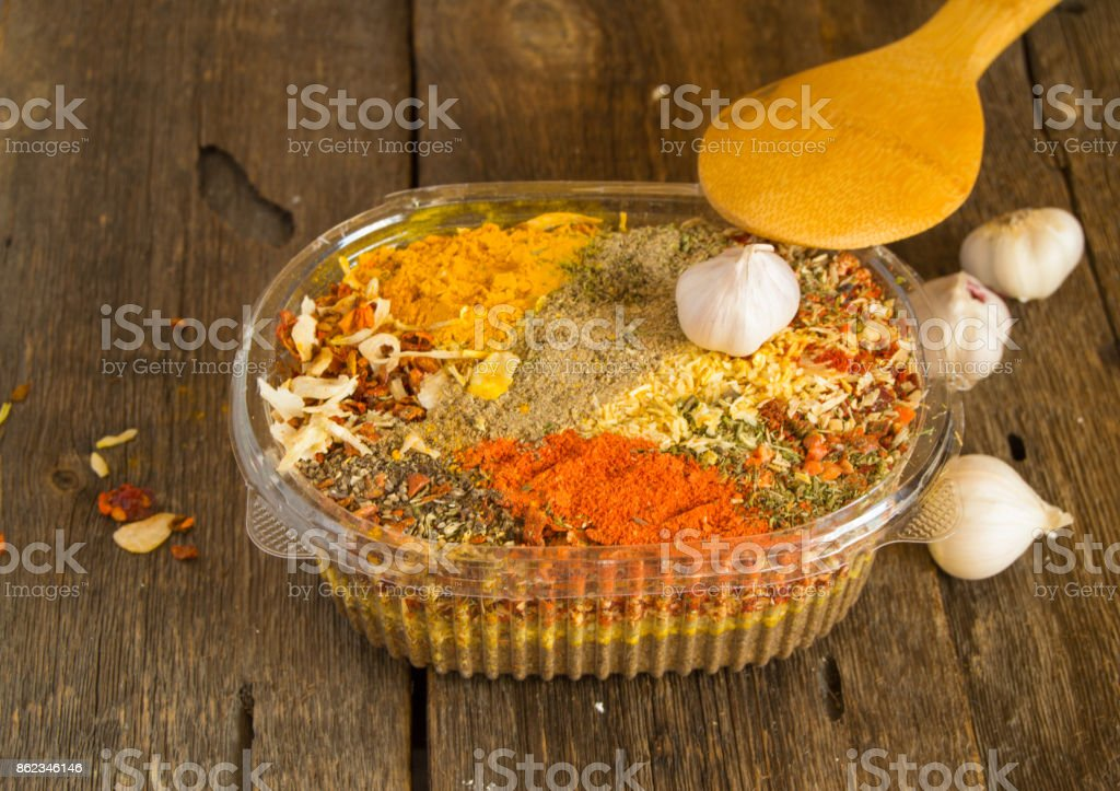 The range of Oriental spices with spicy chilli, curry and a mixture of other spices. Copy space, Old dark wooden background stock photo