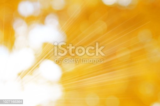 istock The rays of the sun on golden background 1027165364