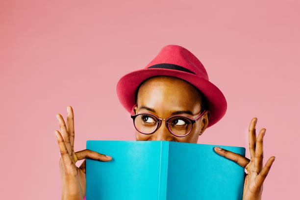 The reader portrait of a happy young woman full of joy holding a book picture id964955312?b=1&k=6&m=964955312&s=612x612&w=0&h=kvdxiy45pfo6wqyynaxg78p9hu aapzhdtt833zkrlu=