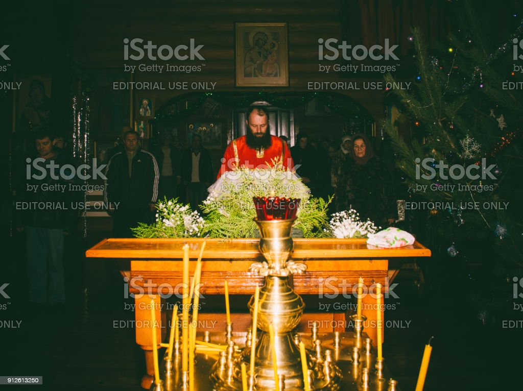 The reader reads the prayers on the night Orthodox service in the Church the holiday of the Epiphanyin Adygea stock photo