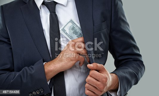 Cropped image of a businessman putting money in his pockethttp://195.154.178.81/DATA/i_collage/pi/shoots/783268.jpg