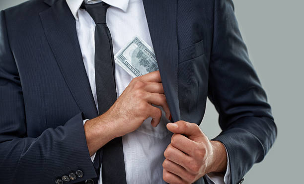 the real criminals wear suits, not ski masks... - paid stock pictures, royalty-free photos & images