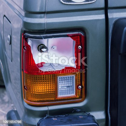The rear lamp of the silver car broken by the accident. Concepts- accident, car insurance, traffic accident.