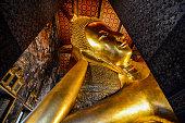 The Reclining Buddha at Wat Pho Pho Temple in Bangkok, Thailand