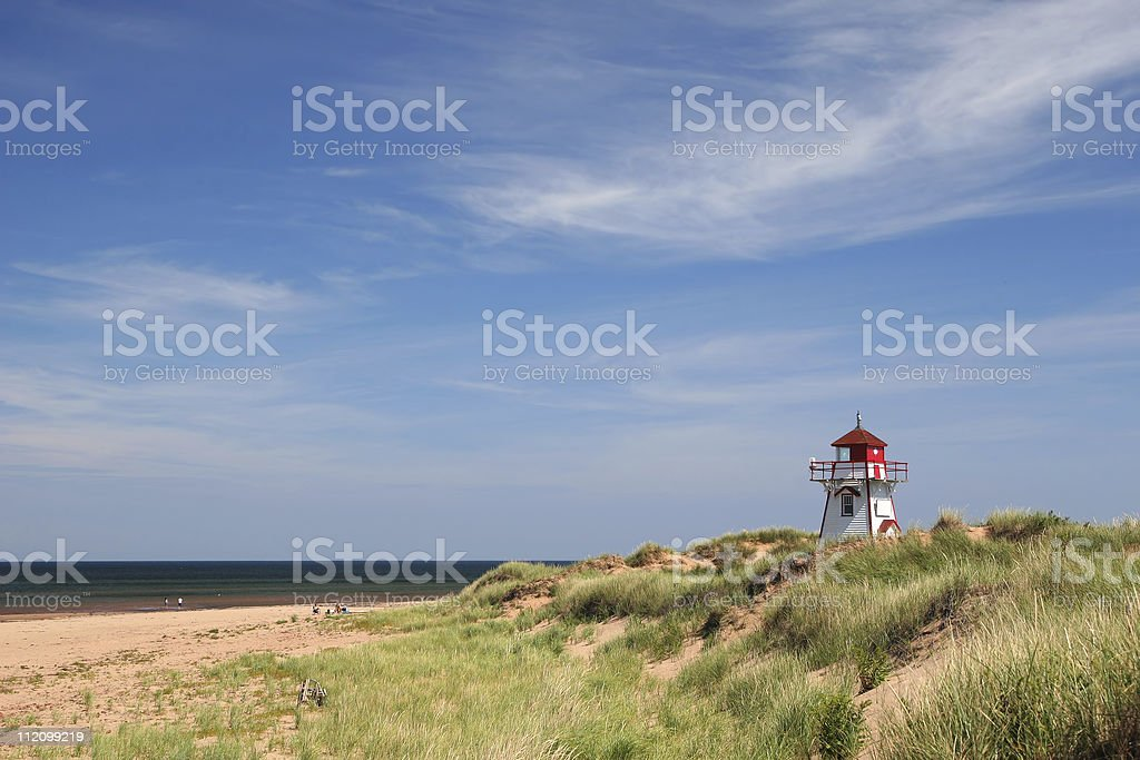 The red and white Dalvay Lighthouse in Prince Edward Island stock photo