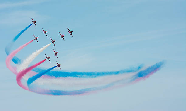 the red arrows colorful smoke trail - arrangement stock pictures, royalty-free photos & images