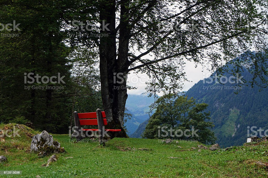 The red bench in the mountains, Switzerland stock photo