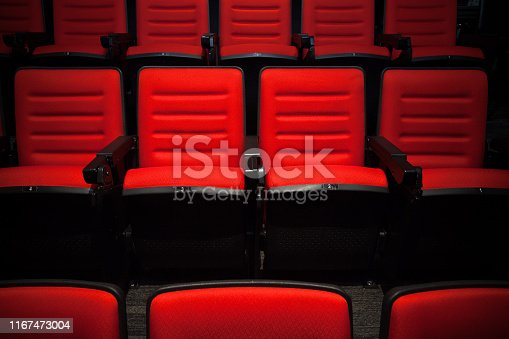 istock The red chairs without people in the cinema, Blurry background. 1167473004