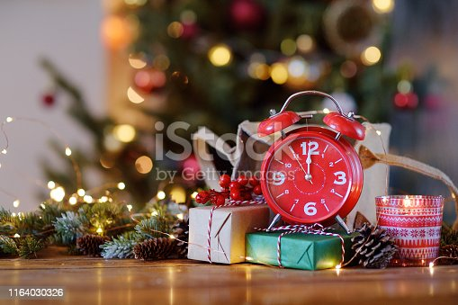 istock The Red clock shows midnight, Christmas night. 1164030326