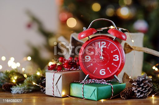 istock The Red clock shows midnight, Christmas night. 1164030327