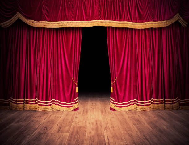 The red curtains are opening for the theater show - foto stock