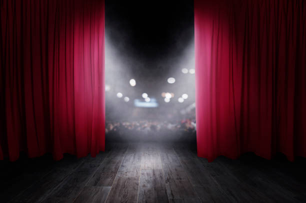 the red curtains are opening for the theater show - curtain stock pictures, royalty-free photos & images