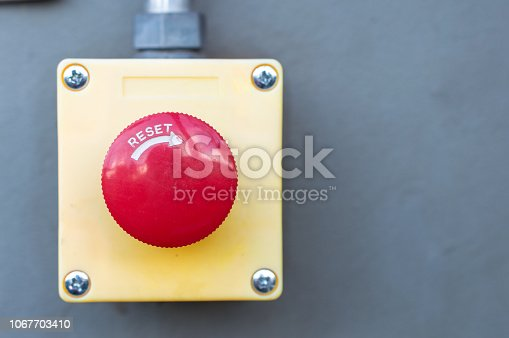 istock The red emergency button or stop button for industrial machine. 1067703410