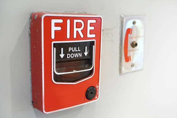 The red fire alarm and equipment on the white wall. stock photo