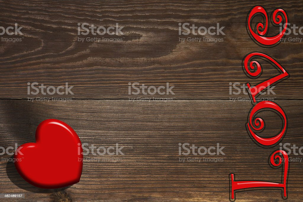 The red heart and inscription on a wooden background stock photo