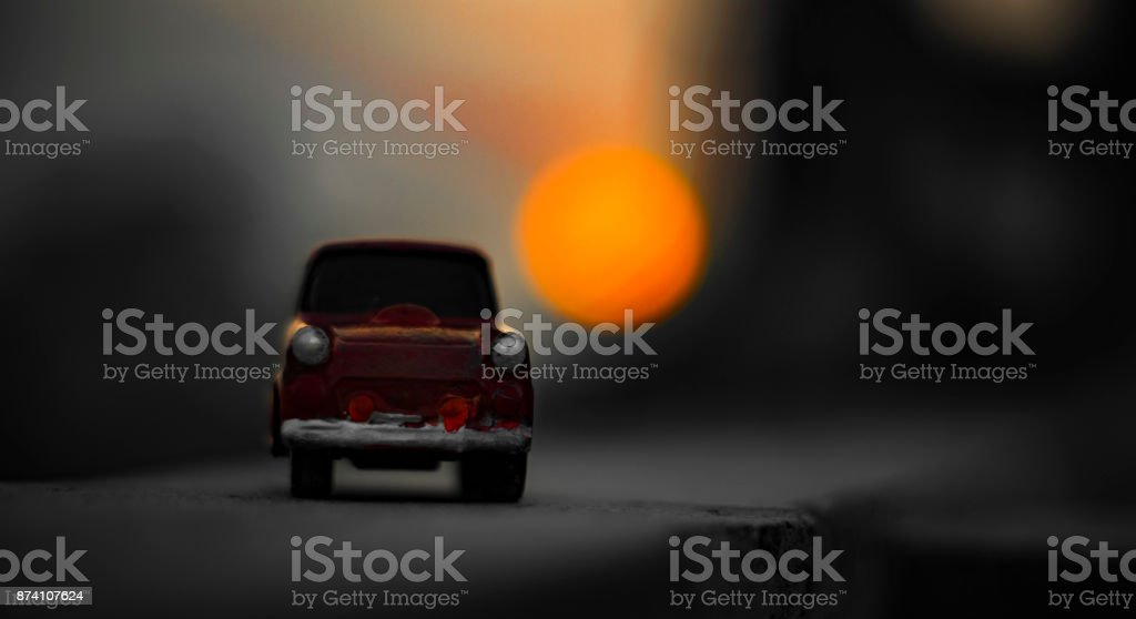 The Red mini car in a Sunset stock photo