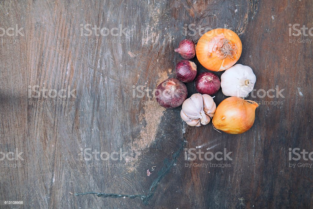 The red onions, onions, garlic and stone mortar. stock photo