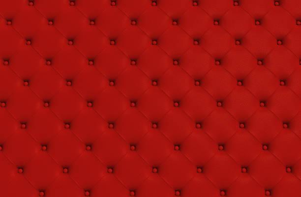 auf der roten textur der haut gesteppte sofa - patchworkstoffe stock-fotos und bilder