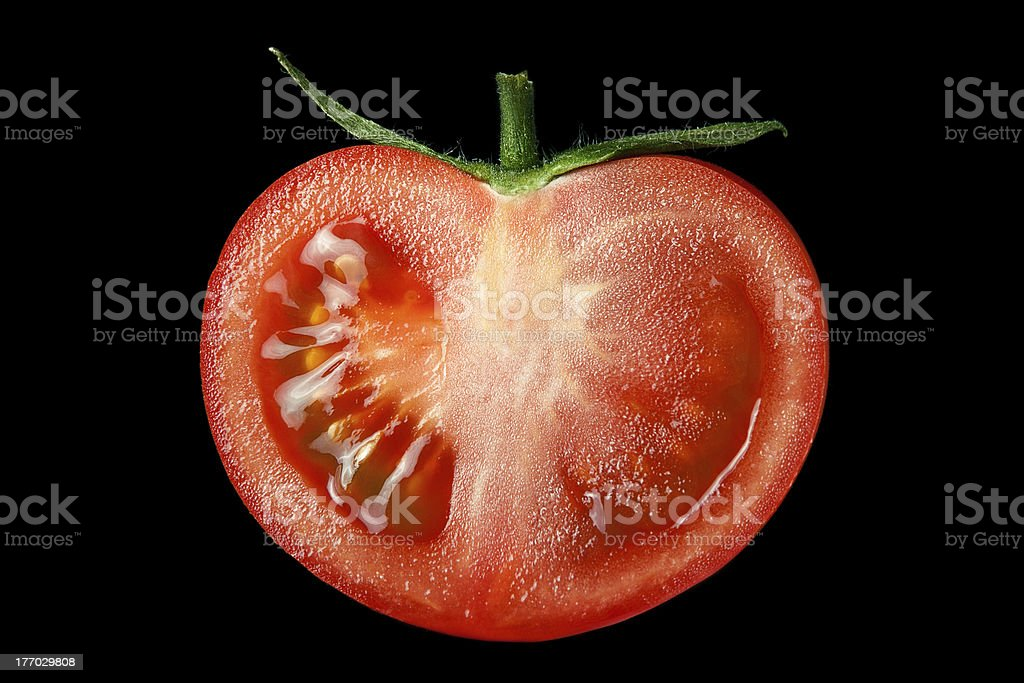 The red tomato cut half-and-half. royalty-free stock photo