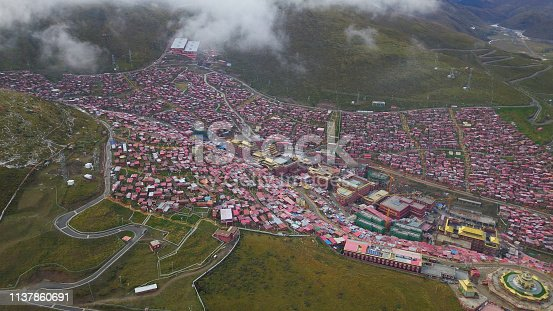 The red village in valley called seda in sichuan, china
