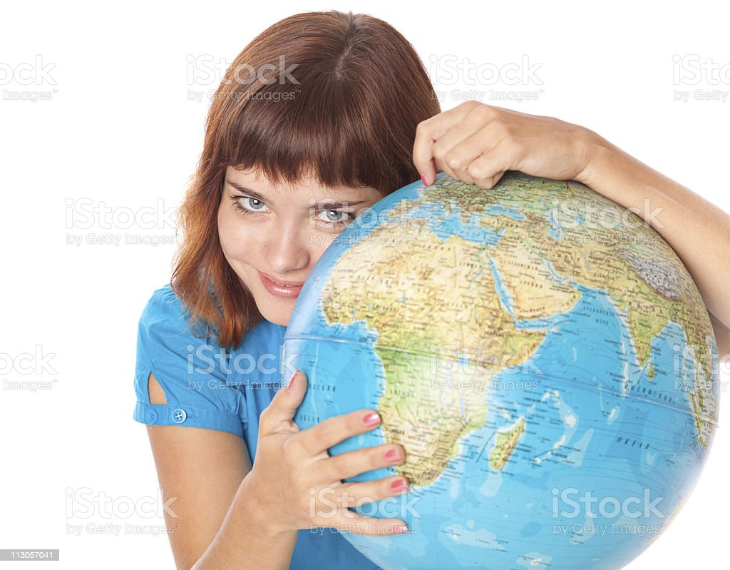 The red-haired girl with globe royalty-free stock photo