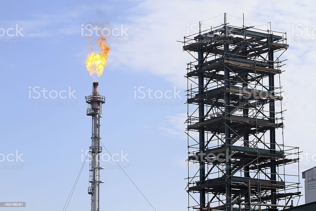 the refinery flare with cloud in background royalty-free stock photo