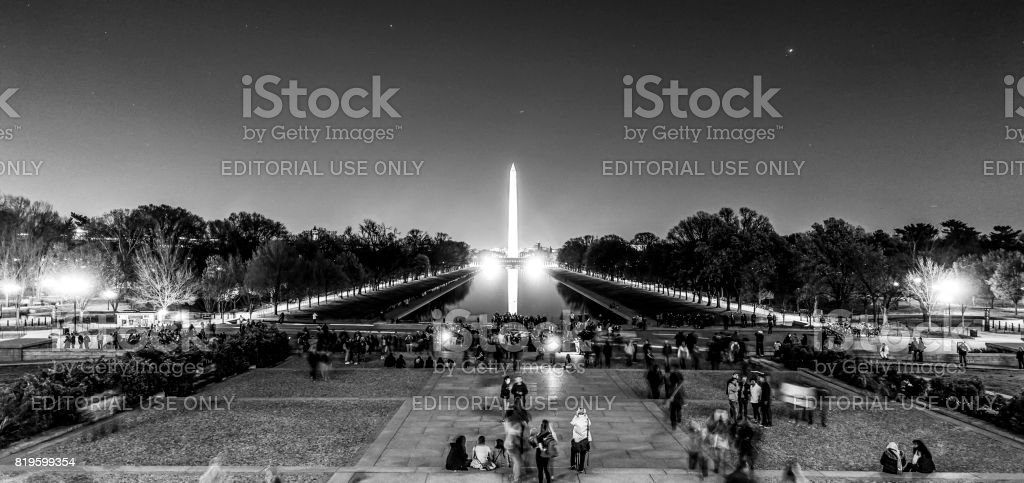 The Reflecting Pool in Washington by night - view from Lincoln Memorial - WASHINGTON DC - COLUMBIA - APRIL 9, 2017 stock photo