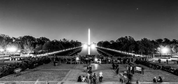 The Reflecting Pool in Washington by night - view from Lincoln Memorial - WASHINGTON DC - COLUMBIA - APRIL 9, 2017 The Reflecting Pool in Washington by night - view from Lincoln Memorial - WASHINGTON DC - COLUMBIA - APRIL 9, 2017 BW ronald reagan washington national airport stock pictures, royalty-free photos & images