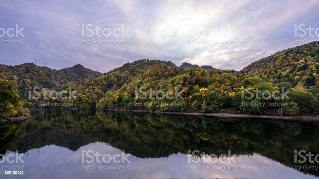 the reflection autumn mountain on the lake stock photo