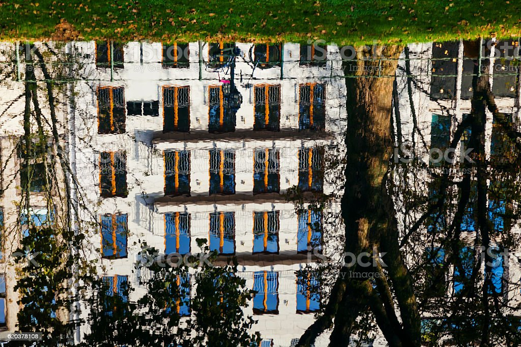 The reflection in water of local buildings in Amsterdam city zbiór zdjęć royalty-free