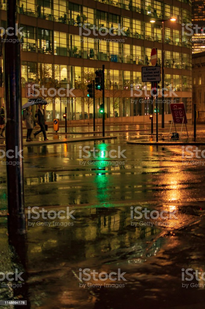 The reflection in wet streets of london during the night and rain in...