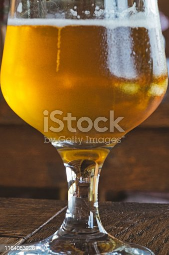 istock The reflection of the bar interior in the glass of cold lager beer 1164083226